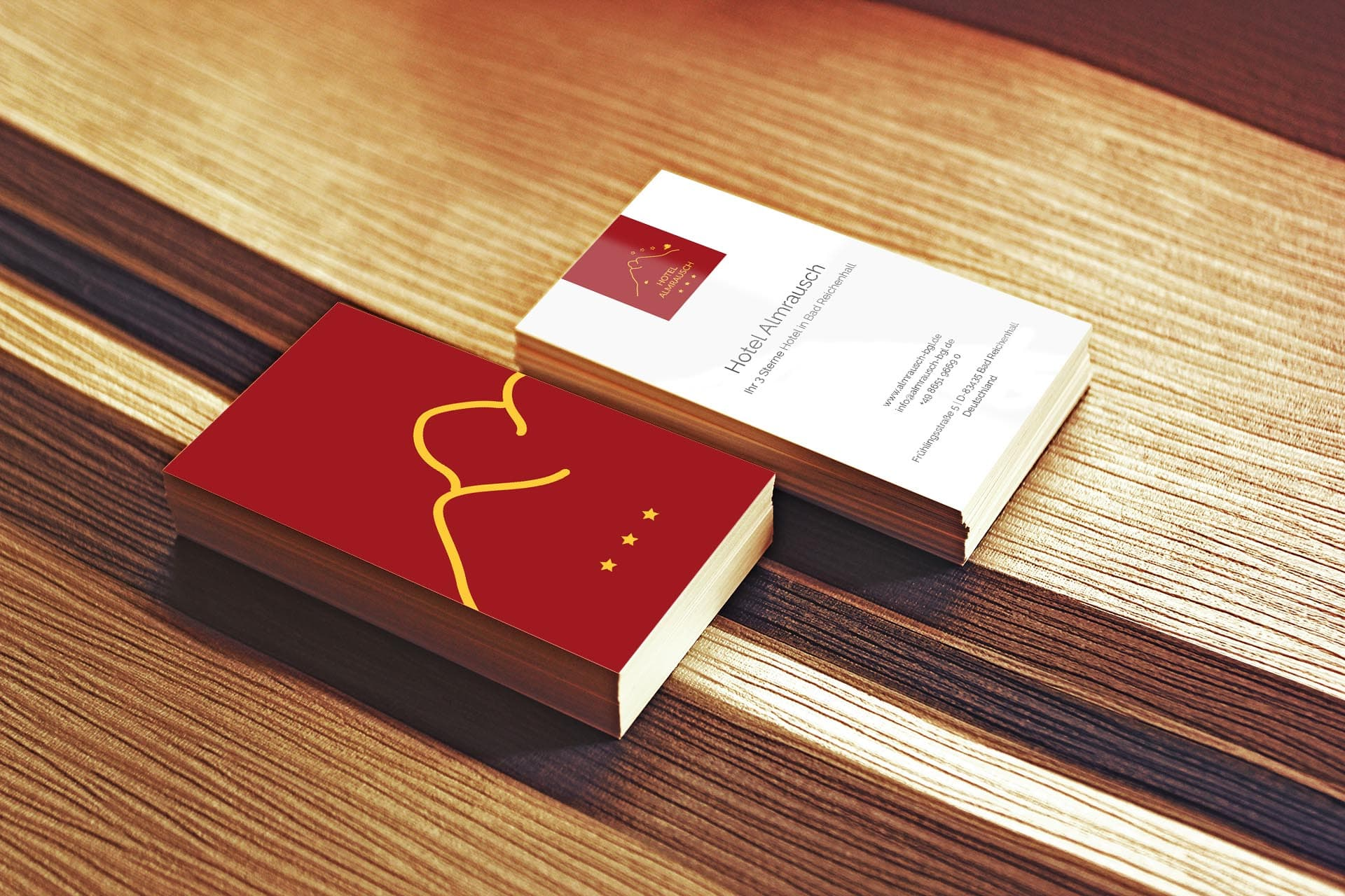 minuteman's Portfolio - Grafikdesign für das Hotel Almrausch in Bad Reichenhall - edle Visitenkarten im kräftigen rot